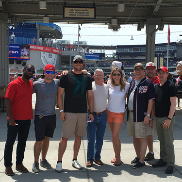 DC Metro Houses team in Washington DC at a Nationals baseball game.
